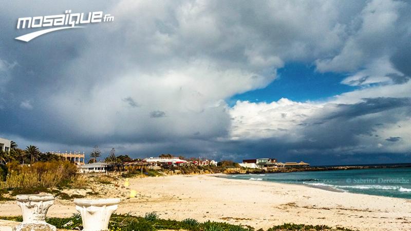 طقس مغيم جزئيا وتوقع نزول أمطار متفرقة يوم الأحد