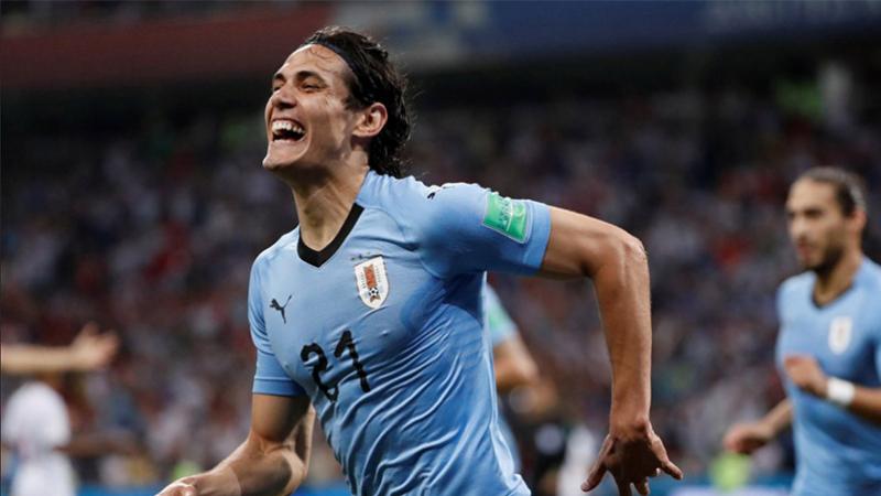 كافاني يسرق الأضواء من رونالدو ويقود الأوروغواي إلى ربع النهائي