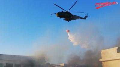 Un hélicoptère appelé en renfort pour éteindre l'incendie de l'usine de fripe