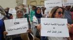 Les représentants des syndicats de l'informatique, communications et de la poste protestent devant le théâtre municipal